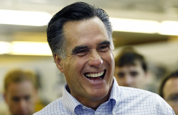 Republican presidential hopeful, former Mass. Gov. Mitt Romney laughs during a campaign stop at a hardware store