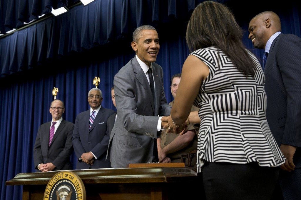 President Barack Obama shakes hands with workers and advocates after signing the Fair Pay and Safe Workplaces executive order on July 31, 2014.