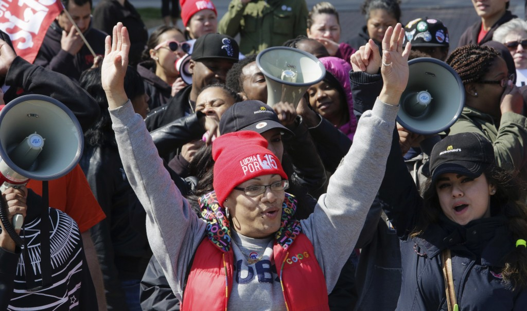 Fast-food worker Maria Rodriguez joins protesters gathered in Chicago on April 14, 2016, to call for a union and pay of $15 per hour.