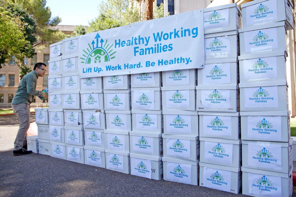 Boxes containing signatures gathered by the Arizona Healthy Working Families Initiative group sit on display in Phoenix, Arizona on  July 7, 2016.