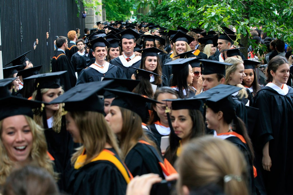 Graduates wait in line after commencement ceremonies in Princeton, New Jersey, on June 5, 2012.