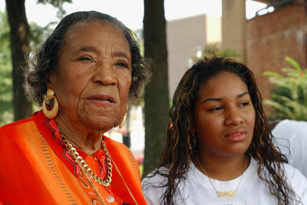 Civil rights leader Amelia Boynton Robinson, left, and high schooler Natalie Ortiz  tour the Martin Luther King Jr. National Historic Site in Atlanta on August 26, 2003.