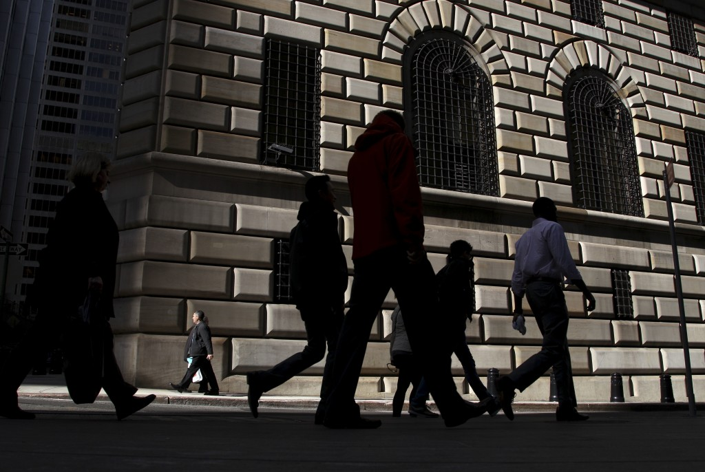 FILE - In this Thursday, Oct. 18, 2012, file photo, pedestrians walk past the Federal Reserve Bank of New York, in New York. On Wednesday, June 15, 2016, the Federal Reserve Bank of New York reports on factory activity in New York in June as indicated by its Empire State manufacturing index. (AP Photo/Seth Wenig, File)