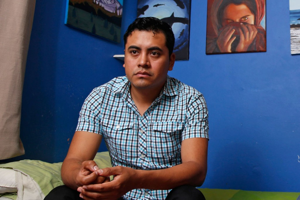 A young immigrant from Mexico poses for a portrait at his home in Paramount, California.