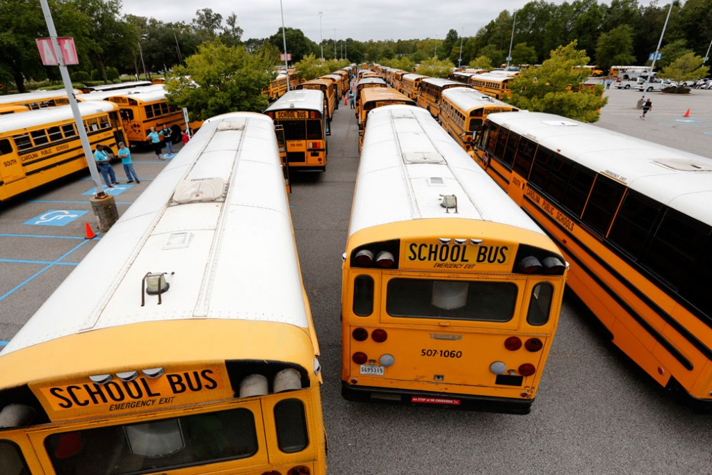 Bus drivers for the Greenville, South Carolina, school district wait by their buses on October 5, 2016.
