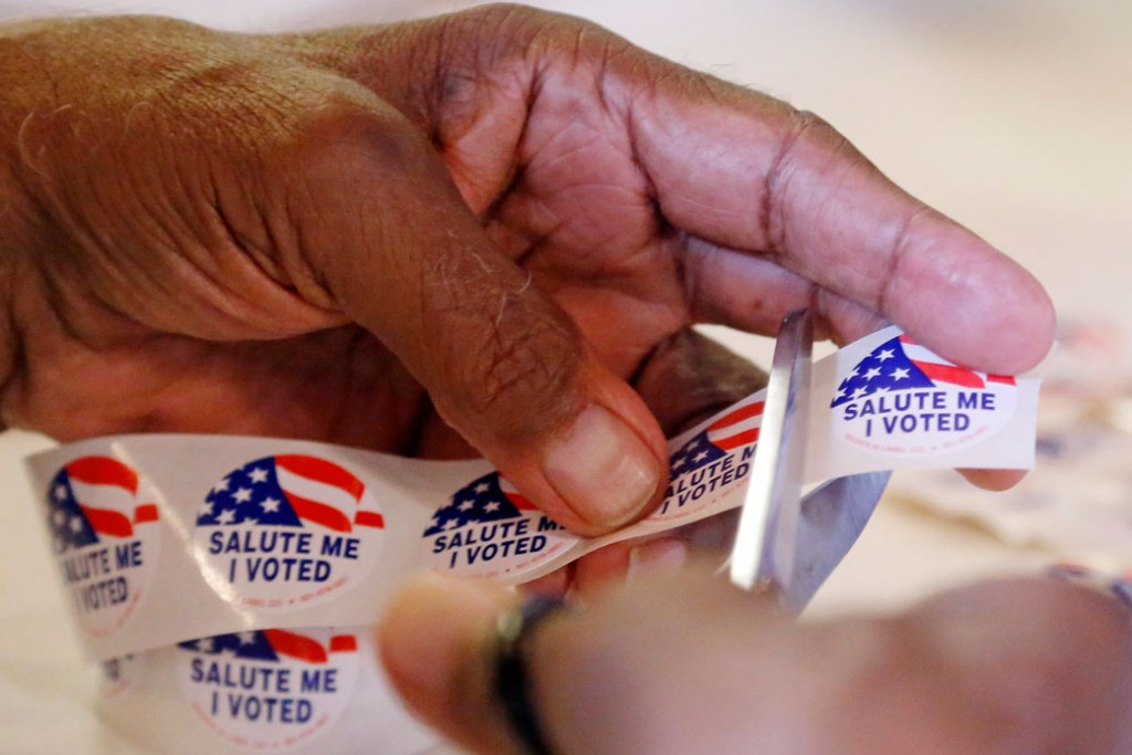 """A precinct manager clips """"I Voted"""" stickers in Jackson, Mississippi, November 2016."""