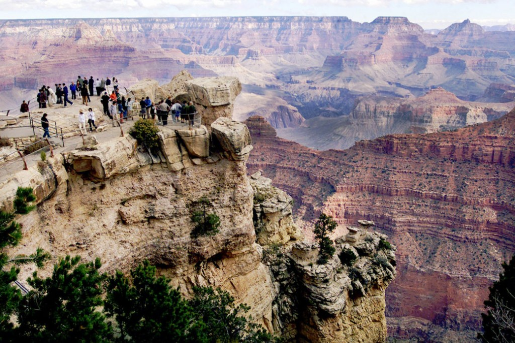 Visitors line the edges of Mather Point at Grand Canyon National Park in Arizona, on October 26, 2000.