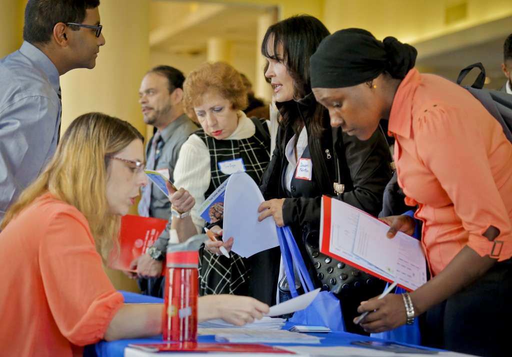Job seekers attend the New York Department of Citywide Administrative Services job fair in New York, November 2, 2016.