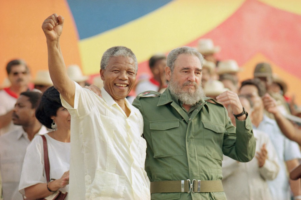 Cuban President Fidel Castro, right, and South African leader Nelson Mandela celebrate the Day of the Revolution in Matanzas, Cuba, on July 27, 1991.