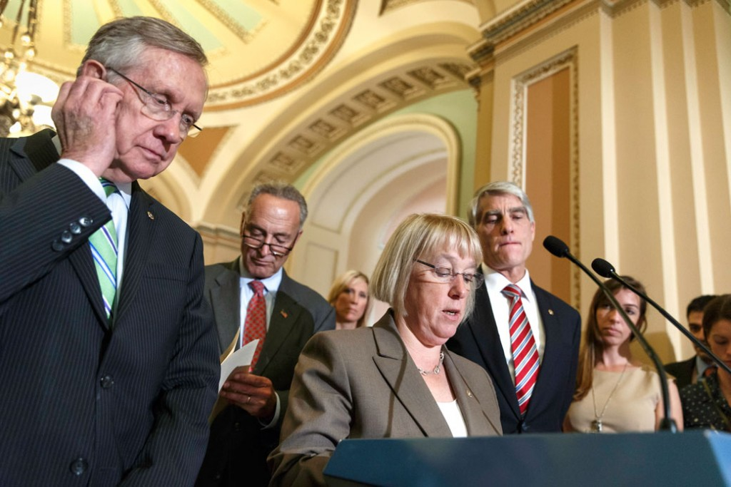 Four U.S. senators talk to reporters on Capitol Hill in Washington, D.C., on July 16, 2014.