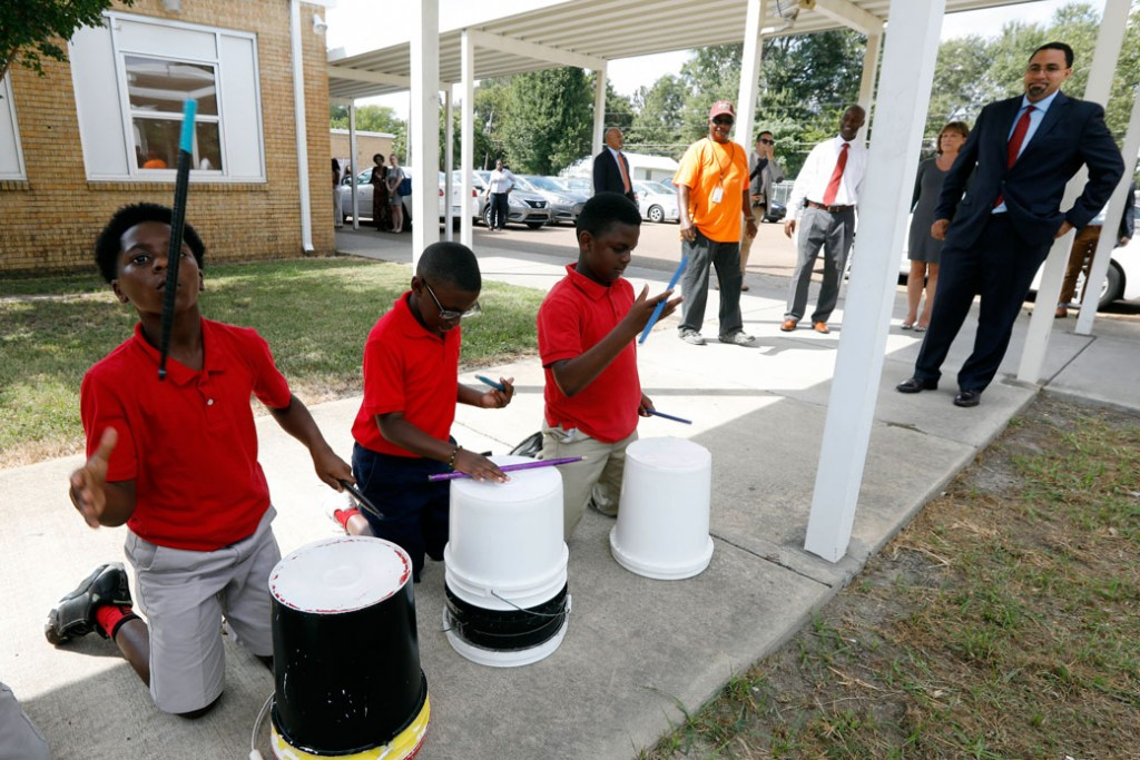 Carver Elementary School students play a welcome beat for U.S. Secretary of Education John King, right, during his visit to their after school tutoring program in Indianola, Mississippi, Thursday, Sept. 15, 2016.