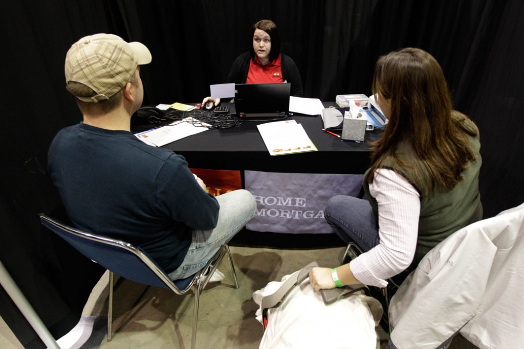 Ryan Gress and his wife Crystal talk with a consumer loan representative in Seattle on  January 12, 2012.