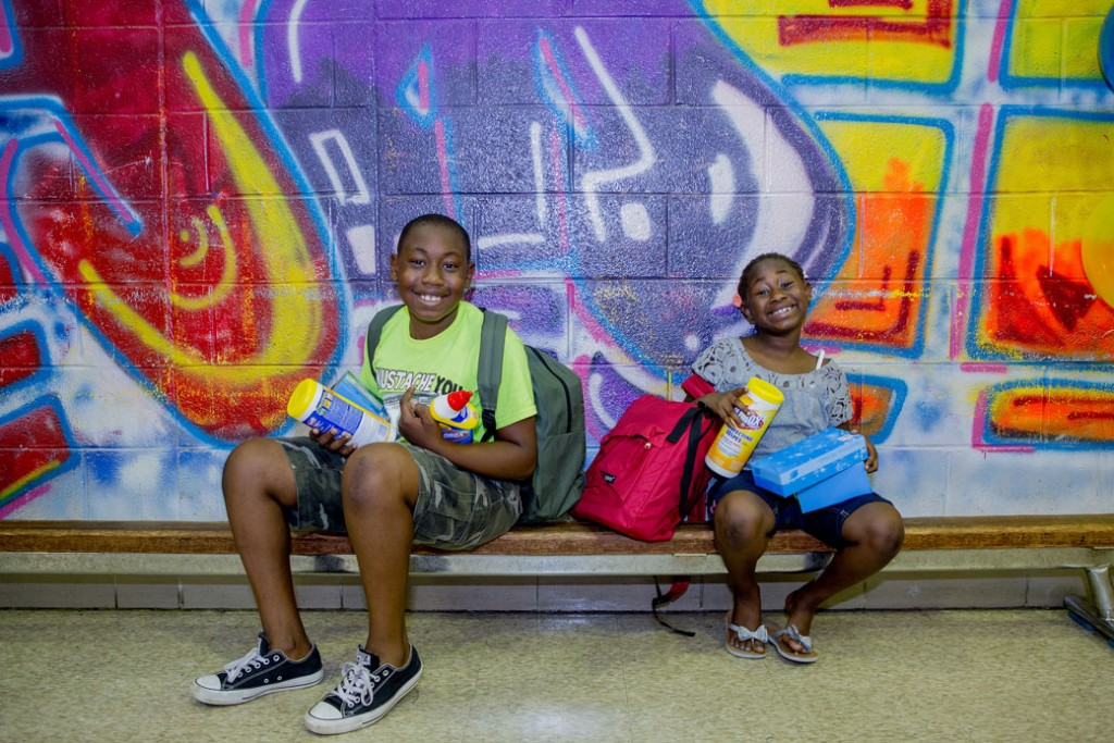 Terrell, left, and Christina Farmer sit on a bench at Philadelphia's Andrew Hamilton School on August 20, 2016.