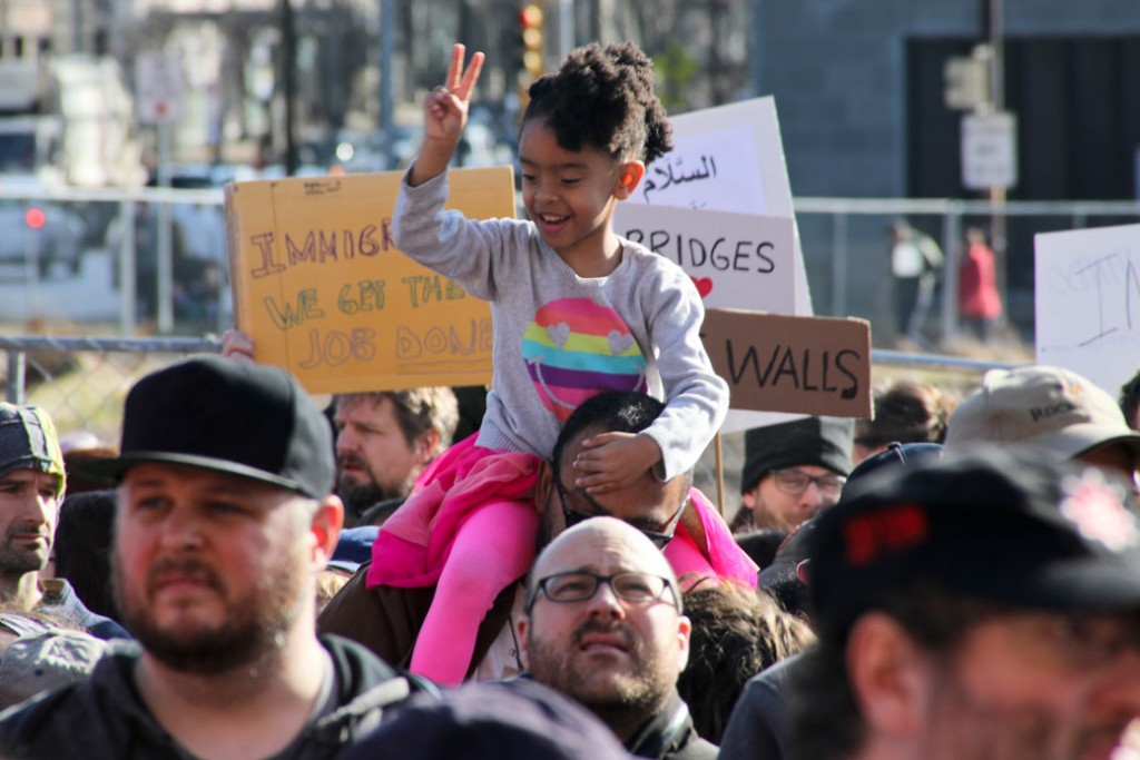 A youngster gives a peace sign in Pittsburgh during one of the women's marches held across the country on January 21, 2017.