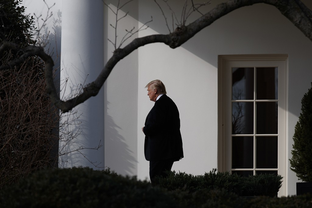 President Donald Trump walks from the Oval Office to board Marine One on the South Lawn of the White House in Washington, January 26, 2017.