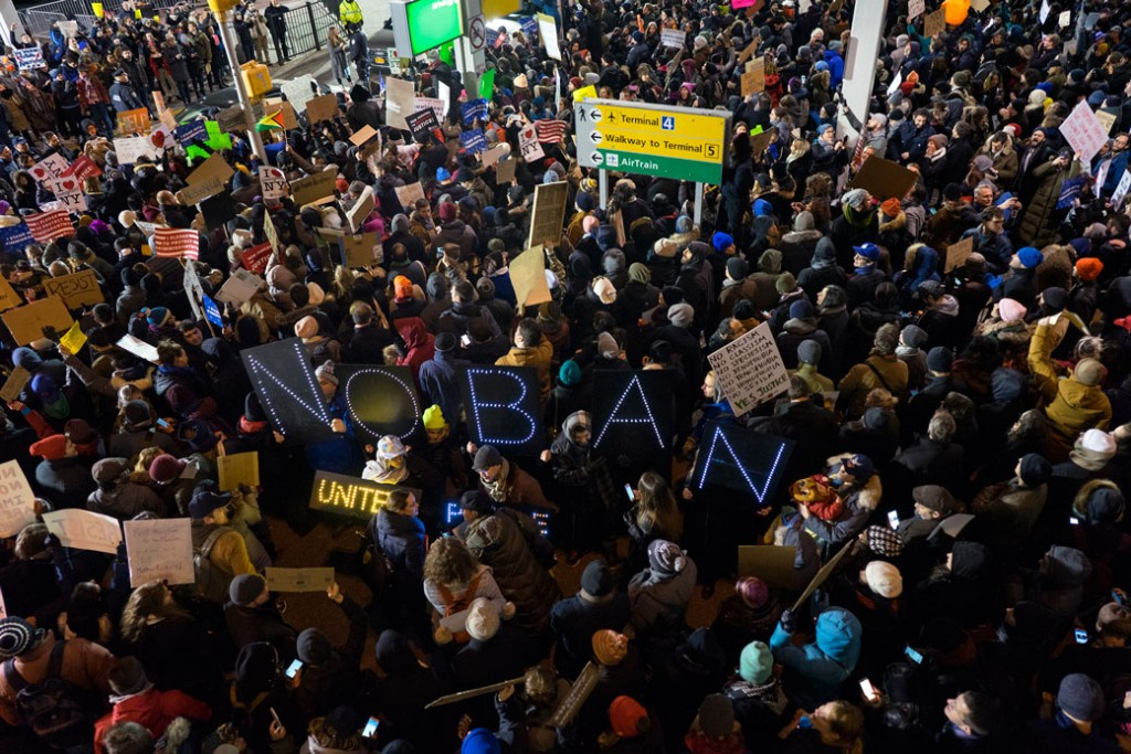 Protesters assemble at John F. Kennedy International Airport in New York, Saturday, January 28, 2017, after two Iraqi refugees were detained while trying to enter the country.