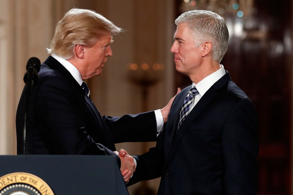 President Donald Trump shakes hands with Judge Neil Gorsuch in the White House on January 31, 2017.