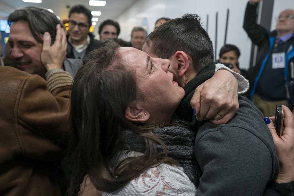 Family members who have just arrived from Syria embrace and are greeted by family who live in the United States upon their arrival at John F. Kennedy International Airport in New York, February 6, 2017.