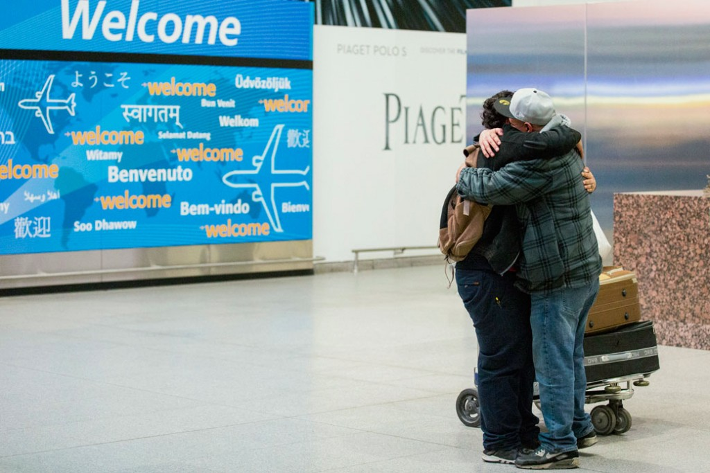 Abdullah Alghazali, right, hugs his 13-year-old son Ali Abdullah Alghazali after the Yemeni boy arrived at John F. Kennedy International Airport in New York, Sunday, February 5, 2017.