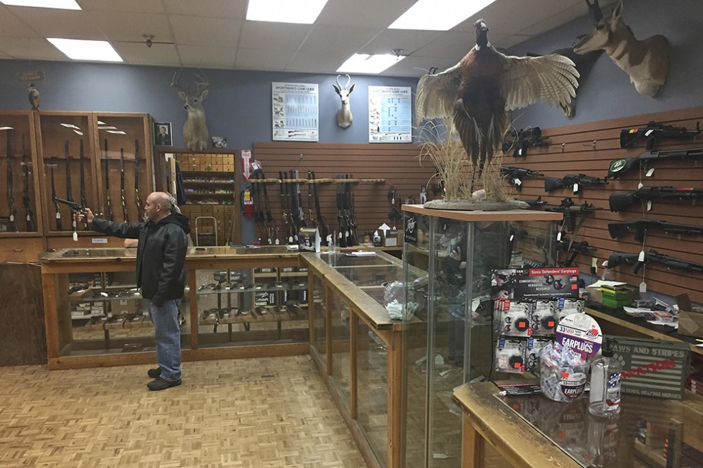 A man handles an unloaded firearm at a gun shop in Santa Fe, New Mexico, January 5, 2017.