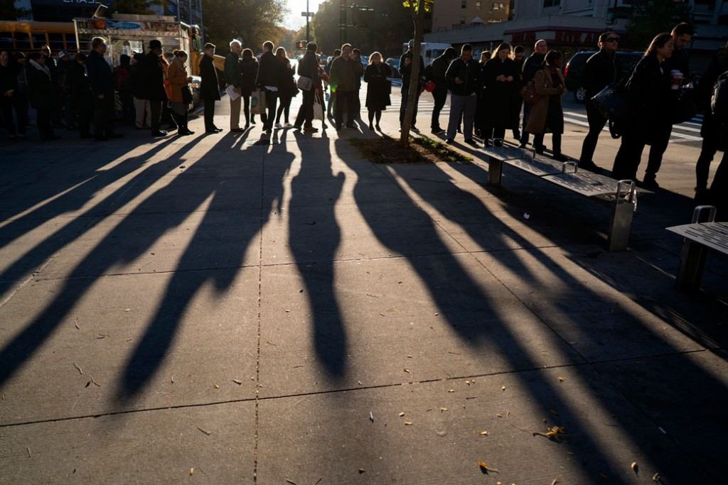 A line forms as people wait to vote on Election Day in the Upper West Side of Manhattan on Tuesday, November 8, 2016, in New York.
