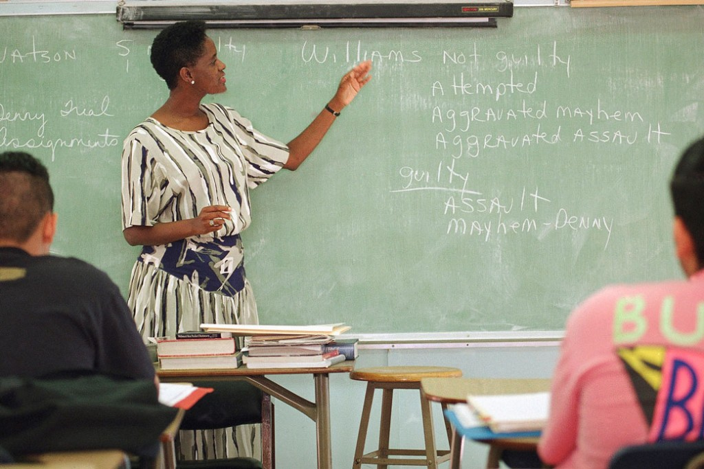 A political science teacher leads students through a discussion of the verdicts in the Reginald Denny beating trial at a Los Angeles high school, October 18, 1993.