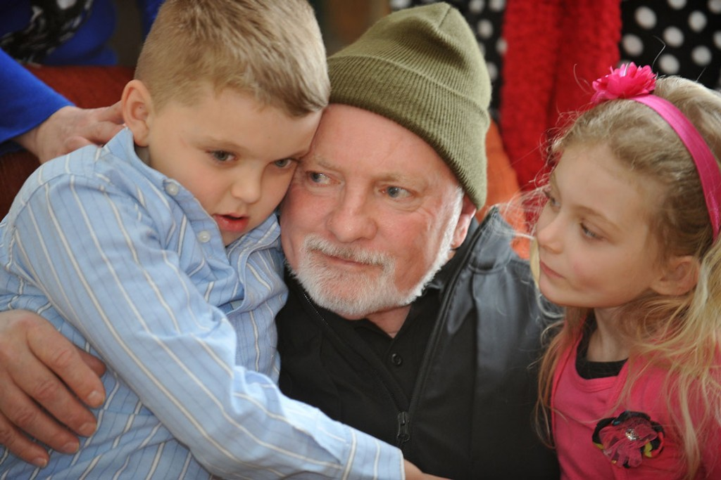 Morris Bounds Sr. sits with his grandchildren on February 23, 2015, in Ansted, West Virginia.