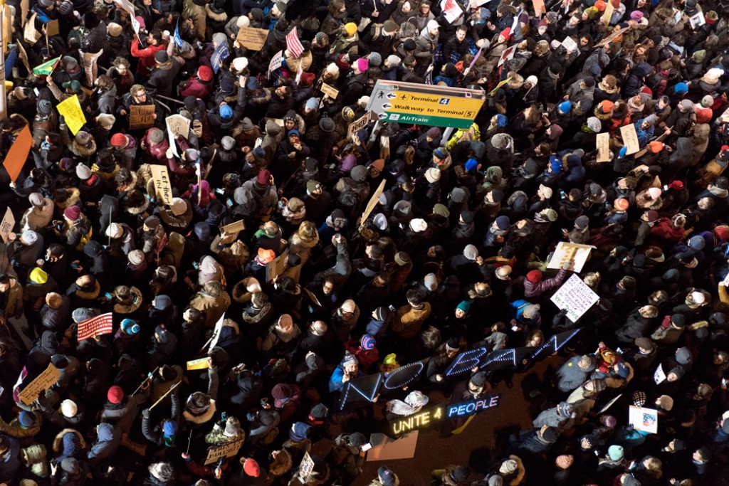 Protesters assemble at John F. Kennedy International Airport in New York, Saturday, Jan. 28, 2017, after earlier in the day two Iraqi refugees were detained while trying to enter the country.