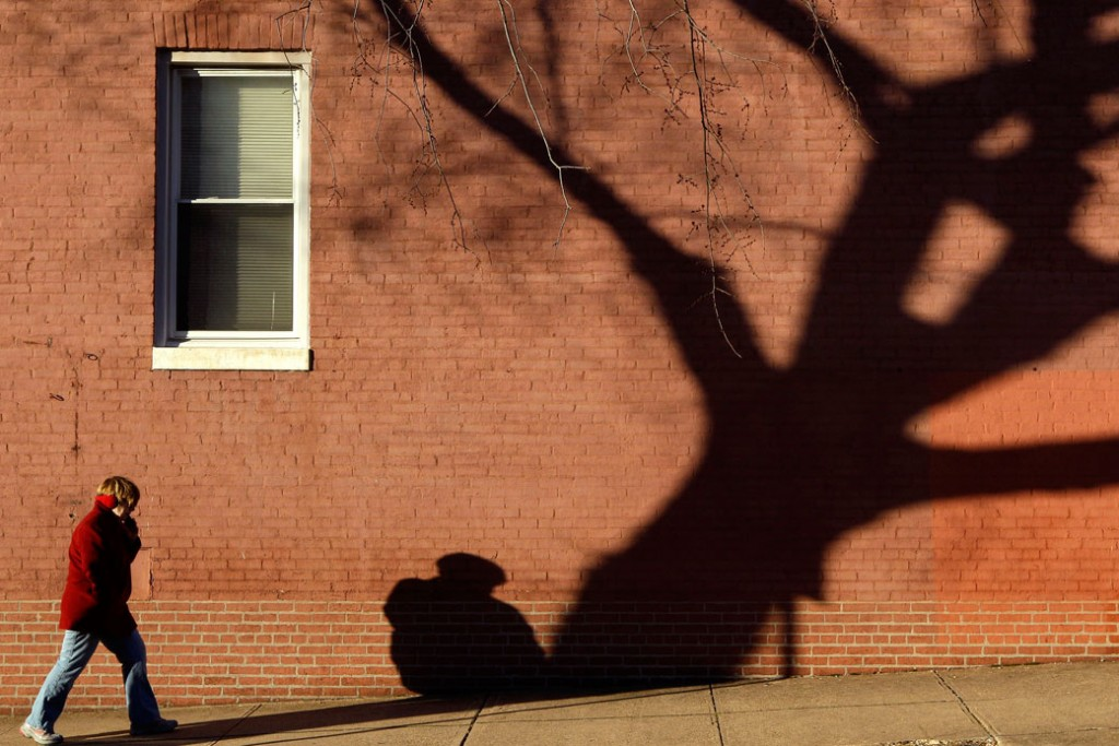 A woman walks on a street in Baltimore, February 6, 2012.