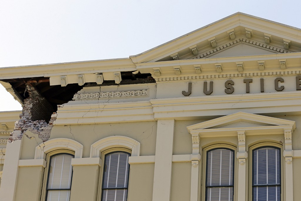 An upper corner of the Napa County Courthouse displays structural damage after an earthquake in Napa, California.