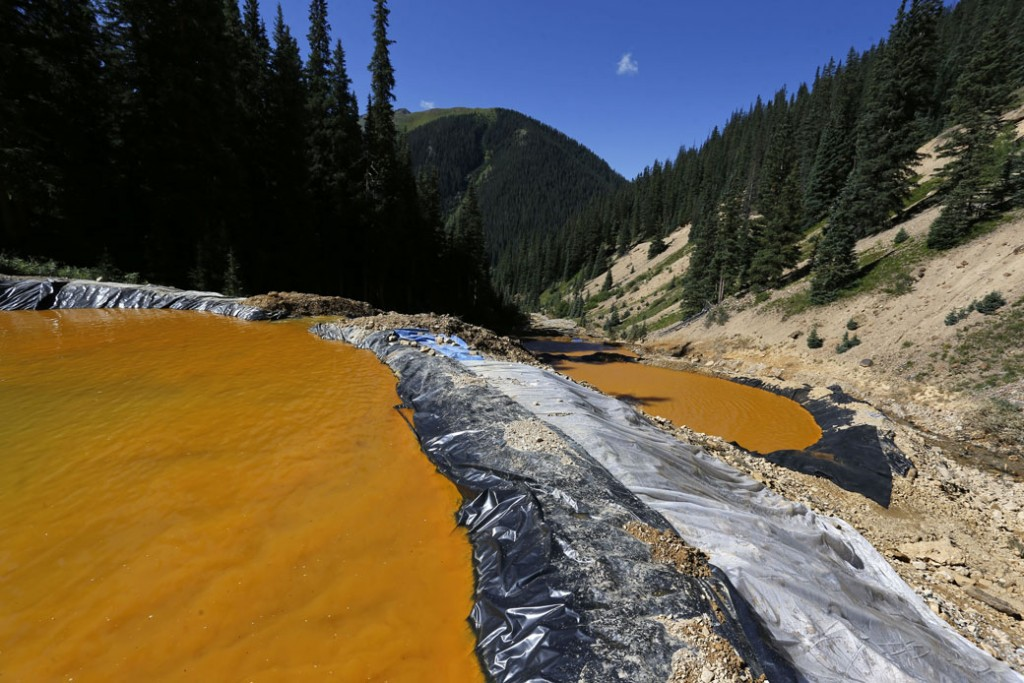 Water flows through sediment retention ponds built to reduce heavy metal and chemical contaminants from the Gold King Mine wastewater accident outside Silverton, Colorado, on August 14, 2015.