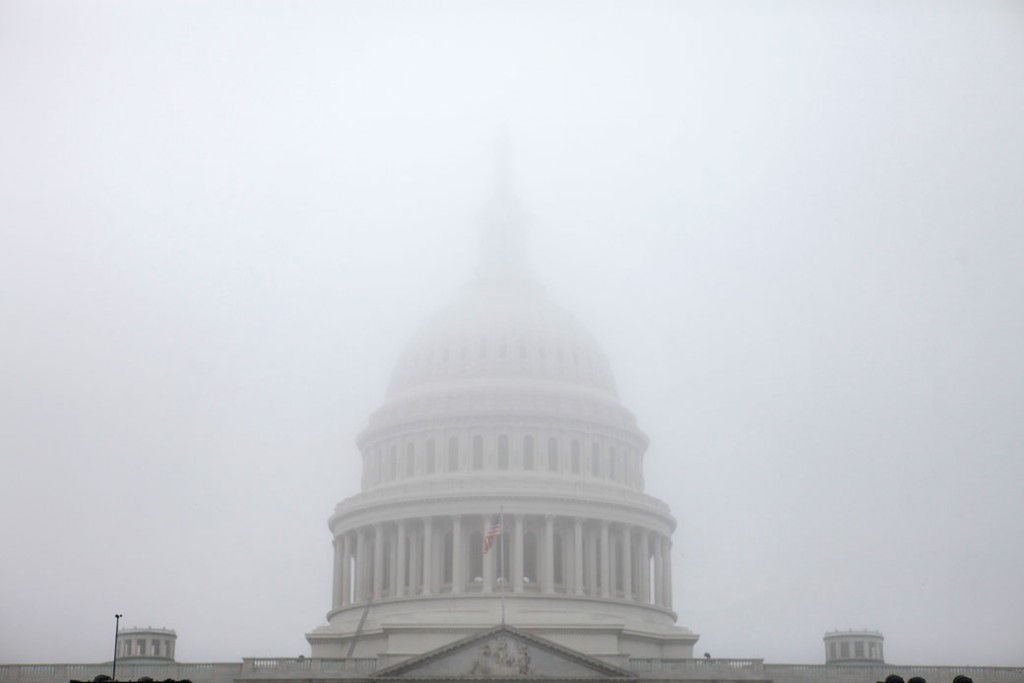The Capitol Dome is seen in a morning fog in Washington, September 2011.