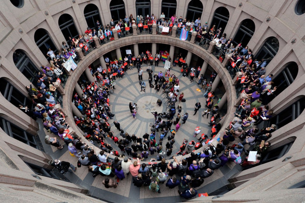 Members of the transgender community and others protest in the exterior rotunda at the Texas state capitol, March 2017.