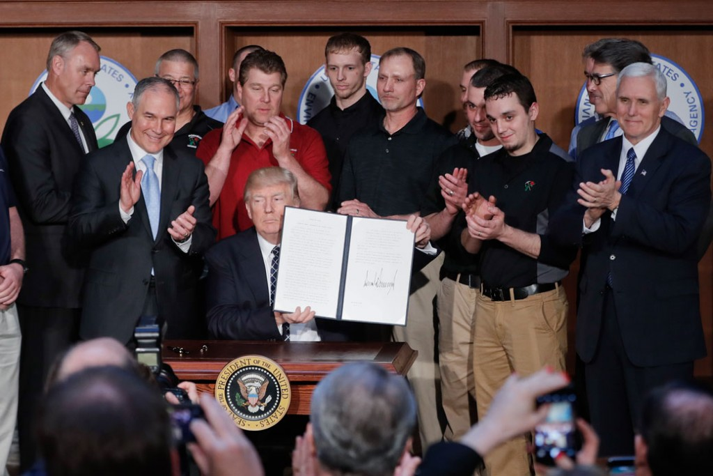 President Donald Trump  holds up the signed Energy Independence Executive Order, March 2017.