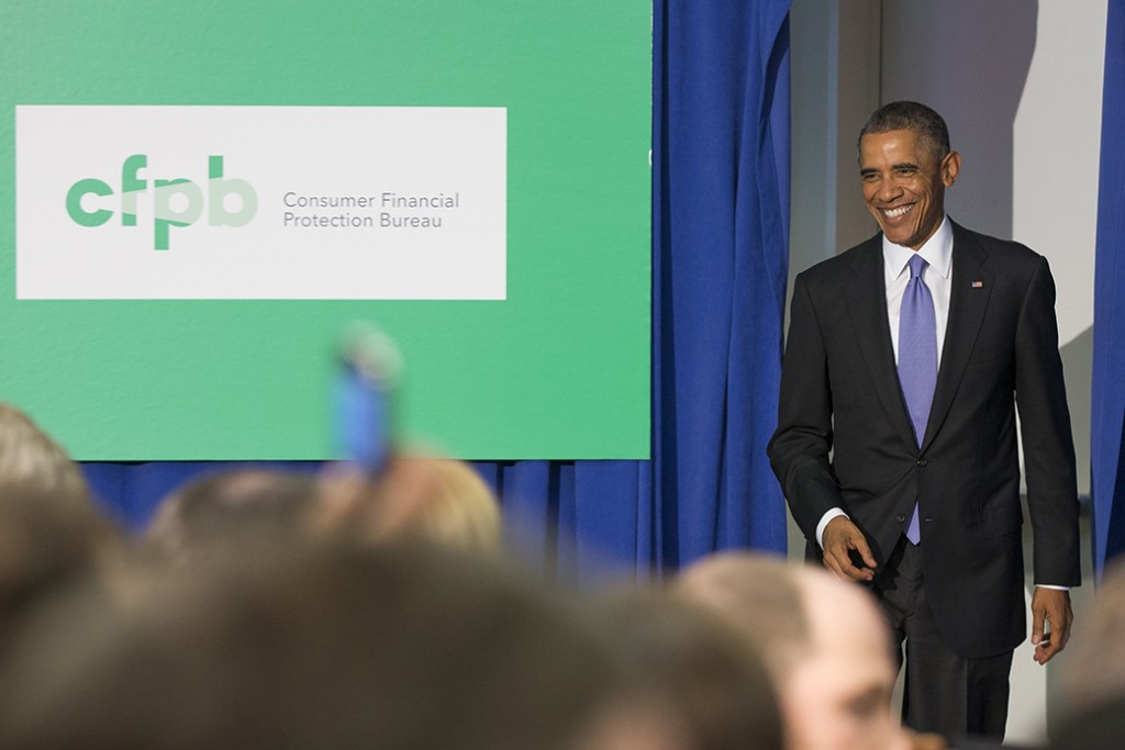 President Barack Obama smiles as he arrives to deliver remarks at the Consumer Financial Protection Bureau, October 17, 2014, in Washington.