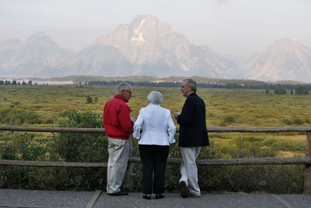 Federal Reserve Chair Janet Yellen, center; Fed Board of Governors Vice Chair Stanley Fischer, left; and Federal Reserve Bank of New York President Bill Dudley view Grand Teton Mountain during a conference on August 26, 2016, in Jackson Hole, Wyoming.