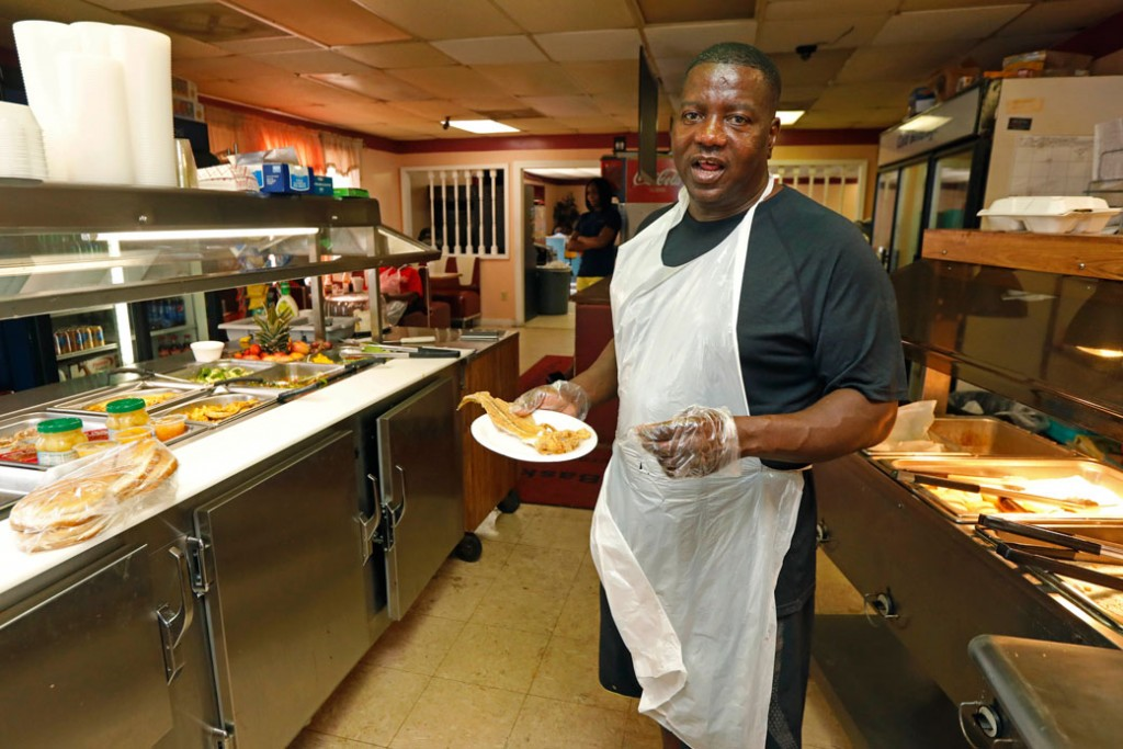 A small-business owner is seen in the kitchen of his restaurant in Belzoni, Mississippi, on  March 23, 2017.