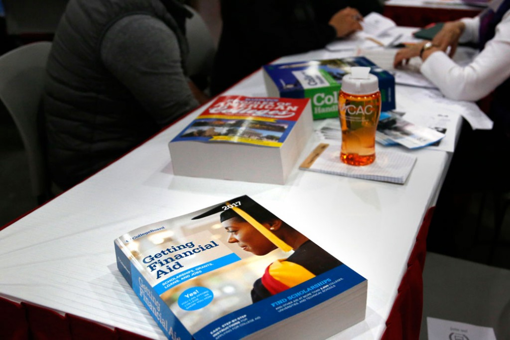 A book about financial aid is seen at a college fair in New York, March 2017.