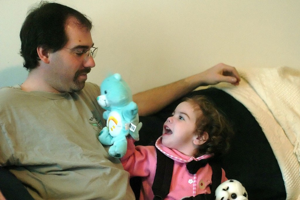 Madeleine Mirante, age 3, plays with her father, Christopher Mirante, in their living room in Plainfield, Connecticut, on April 1, 2005.