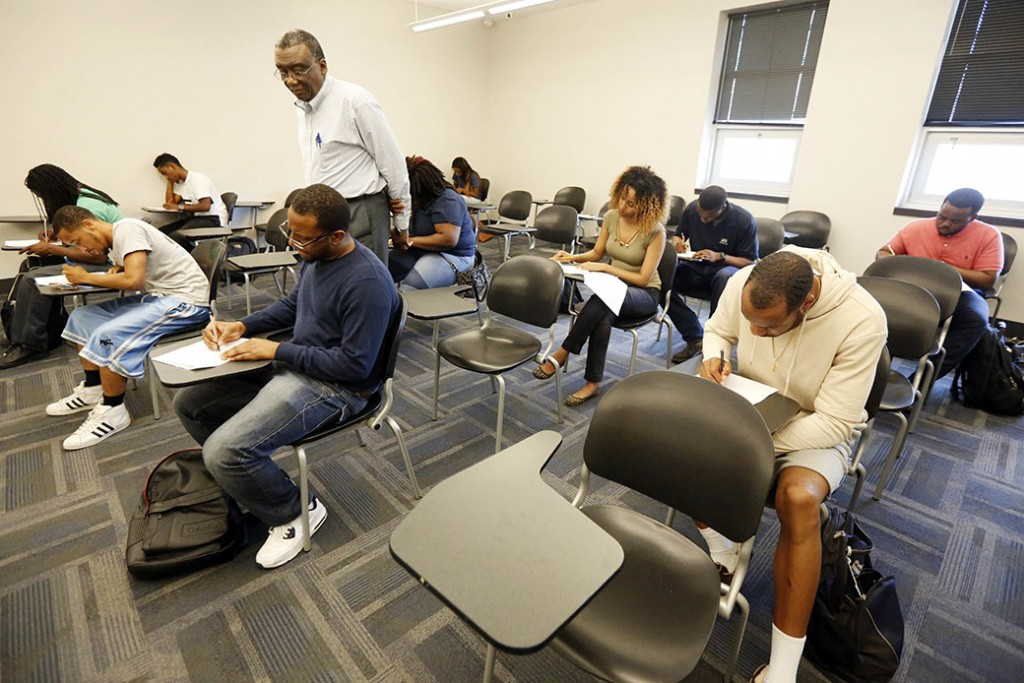 A professor monitors his students as they take a final exam at Jackson State University in Jackson, Mississippi, April 20, 2017.
