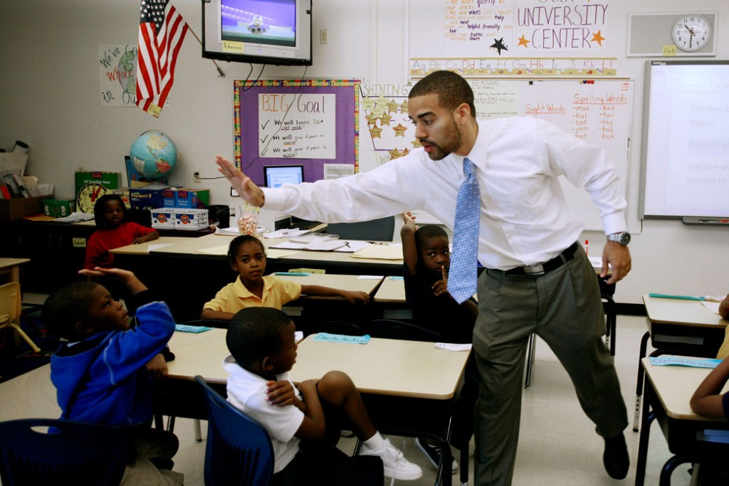 A teacher high fives a student at an elementary school in Miami, September 1, 2011.
