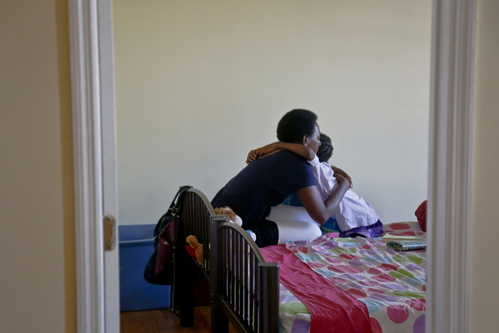 A mother hugs her daughter during a chat, July 2016.