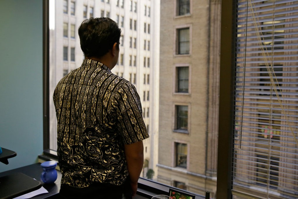 An Indonesian fisherman who escaped slavery looks out the window at the San Francisco offices of the Legal Aid Society on September 22, 2016.