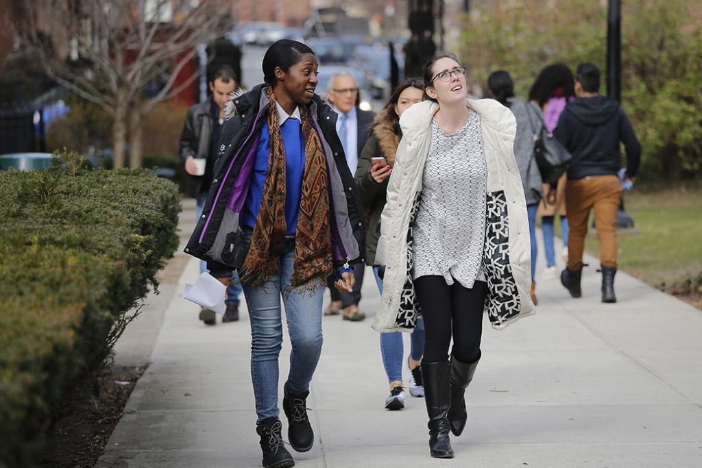 Students walk across a campus for class, February 2017.