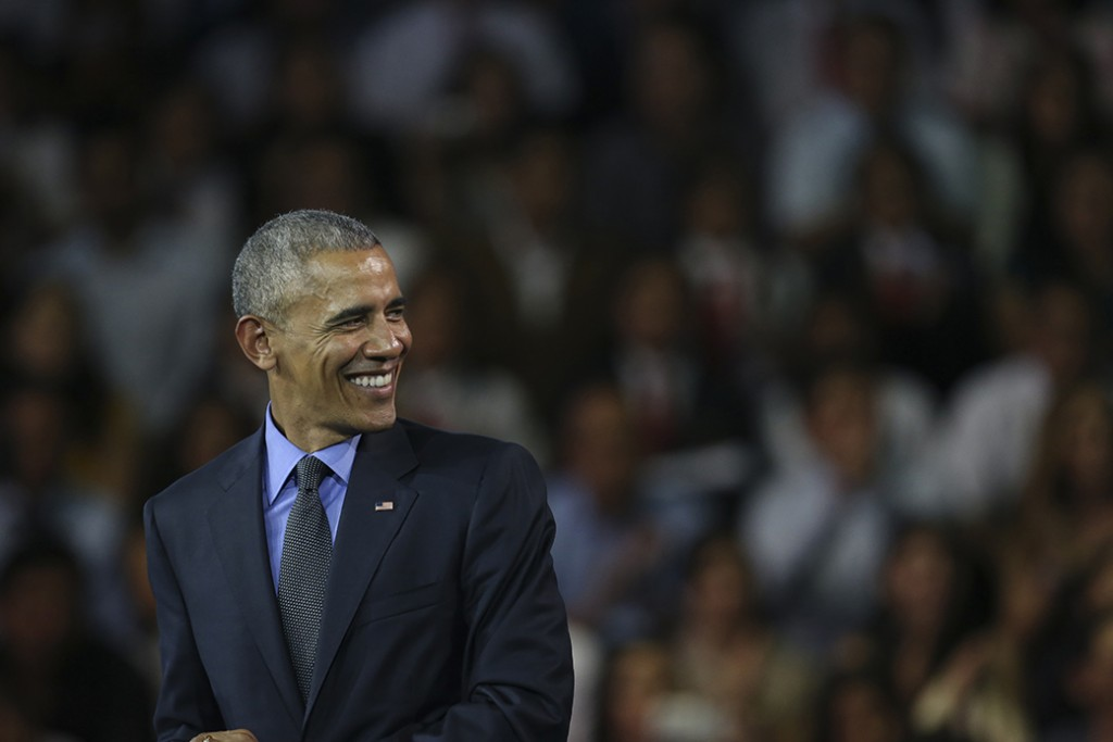 Former President Barack Obama smiles during a speech at a town hall with the Young Leaders of the Americas Initiative in Lima, Peru, November 19, 2016.