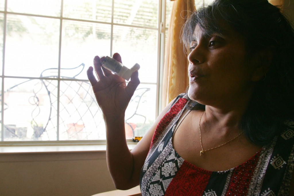 Ana Maria Corona holds her asthma medication on August 7, 2007, in Arvin, California.