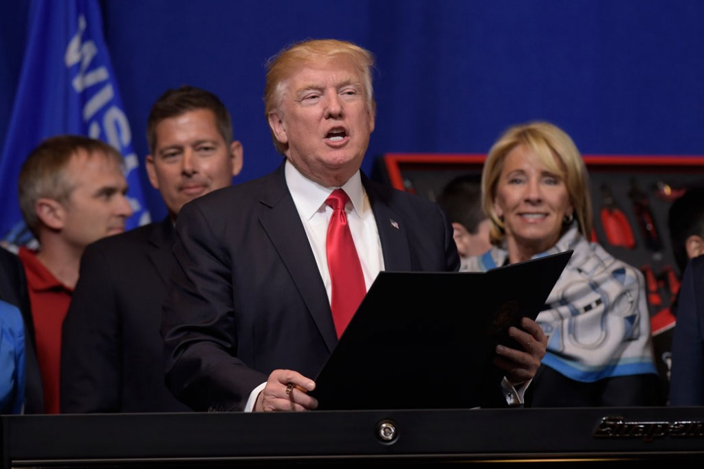 President Donald Trump and Education Secretary Betsy DeVos are seen in April 2017.