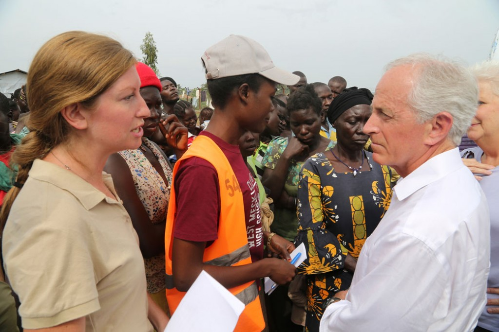Sen. Bob Corker (R-TN), right, speaks with an official from the World Food Program at the Bidi Bidi refugee settlement in Uganda on April 14, 2017.