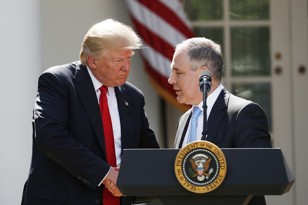 President Donald Trump shakes hands with EPA Administrator Scott Pruitt after speaking in the Rose Garden of the White House in Washington, June 1, 2017.