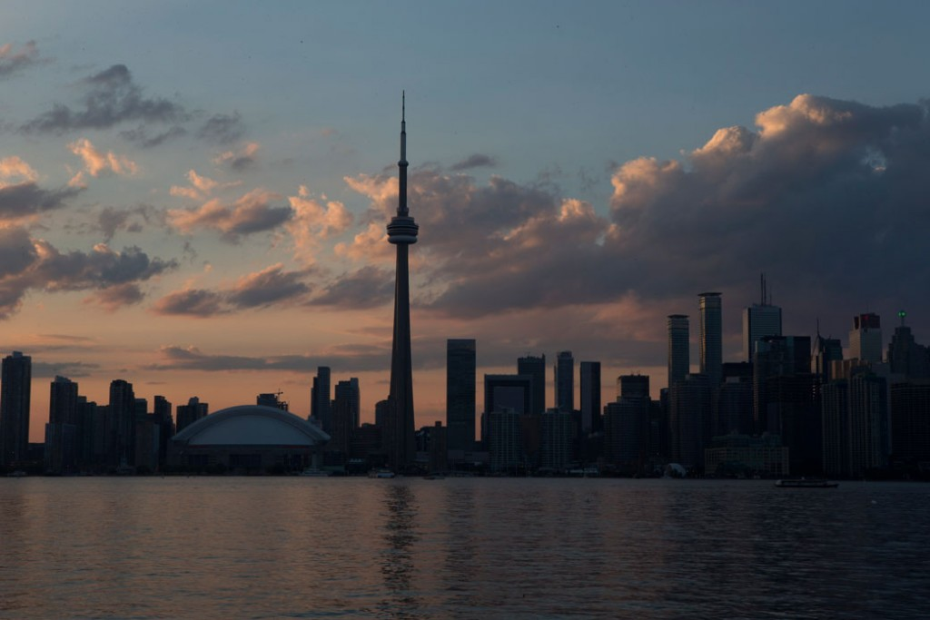 The sun sets over the Toronto skyline, July 2015.